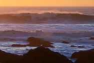 Waves breaking at sunset, San Mateo County coast, California