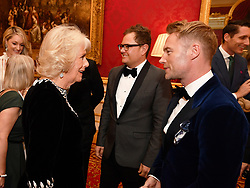 The Duchess of Cornwall talks with Ronan Keating at the Julien Macdonald Fashion Show Reception at Lancaster House in London, which is supporting the National Osteoporosis Society charity.