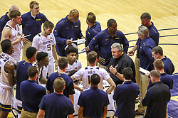 Dec 1, 2019; Morgantown, WV, USA; West Virginia Mountaineers head coach Bob Huggins talks with his team during a timeout during the first half against the Rhode Island Rams at WVU Coliseum. Mandatory Credit: Ben Queen-USA TODAY Sports