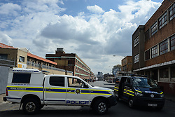 Police vehicles are seen at the site of xenophobic attacks in Johannesburg Town, South Africa, on April 17, 2015. South African police on Friday fired rubber bullets to disperse rioters in central Johannesburg, a fresh hotbed of xenophobia violence. The current spate of xenophobic violence mainly affects Durban and Johannesburg. According to official figures, five people have been killed and thousands of immigrants displaced. EXPA Pictures © 2015, PhotoCredit: EXPA/ Photoshot/ Zhai Jianlan<br /> <br /> *****ATTENTION - for AUT, SLO, CRO, SRB, BIH, MAZ only*****