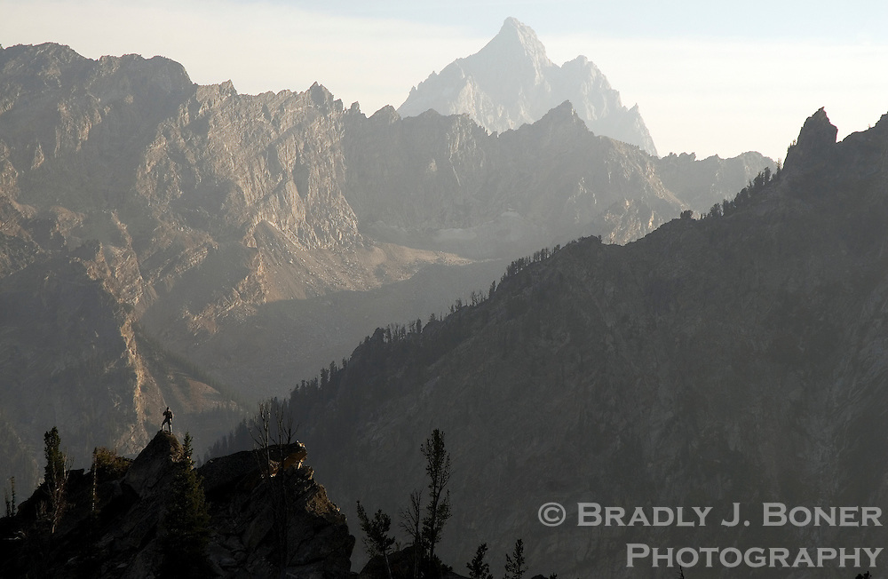 David Stubbs takes in the view of Paintbrush Canyon and the Grand Teton from the CMC Camp at 10,000 feet on the east face of Mount Moran, Grand Teton National Park, Wyo.
