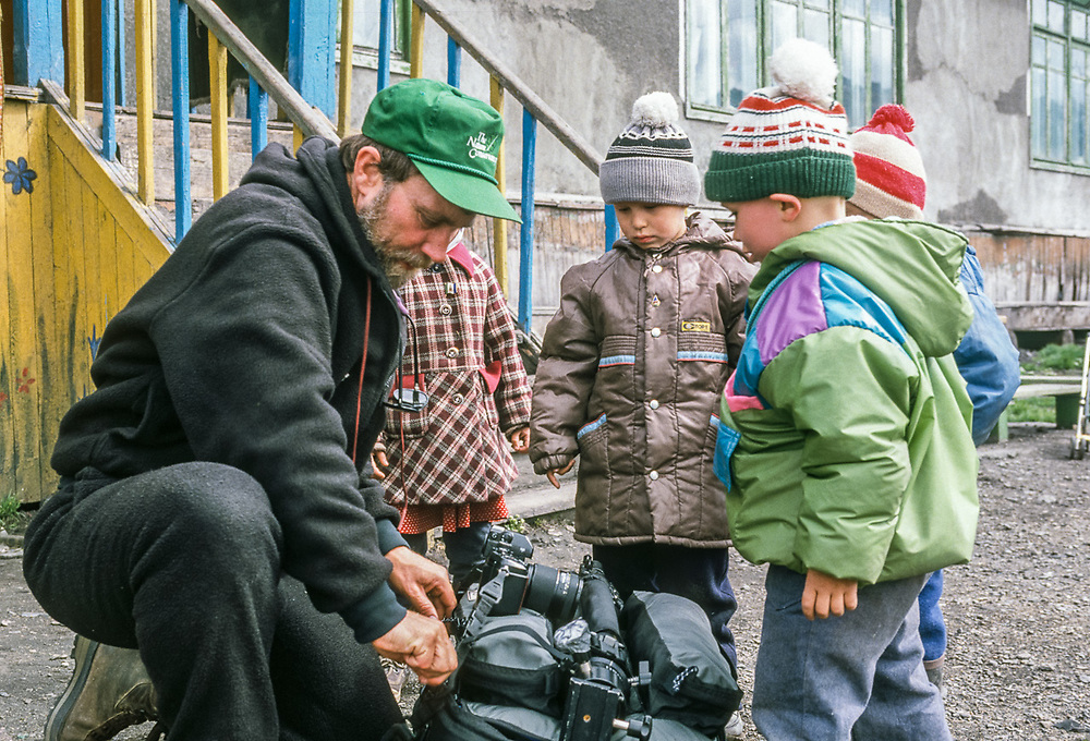 Pat O'Hara and curious children, Village of Uelen, Chukotsk Peninsula, Northeast Russia. Photo by Dave Wukasch, 1992