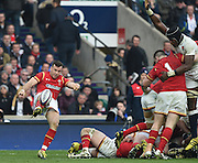 Twickenham. Great Britain.<br /> Gareth DAVIES, kicks clear from behind the scrum at Wales prop Rob EVANS holds of, England Lock, Maro ITOJE, during the <br /> RBS Six Nations Rugby, England vs Wales at the RFU Twickenham Stadium. England.<br /> <br /> Saturday  12/03/2016 <br /> <br /> [Mandatory Credit; Peter Spurrier/Intersport-images]