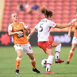 BRISBANE, AUSTRALIA - NOVEMBER 17: Tameka Butt of the Roar and Jenna McCormick of Adelaide compete for the ball during the round 4 Westfield W-League match between the Brisbane Roar and Adelaide United at Suncorp Stadium on November 17, 2017 in Brisbane, Australia. (Photo by Patrick Kearney / Brisbane Roar)