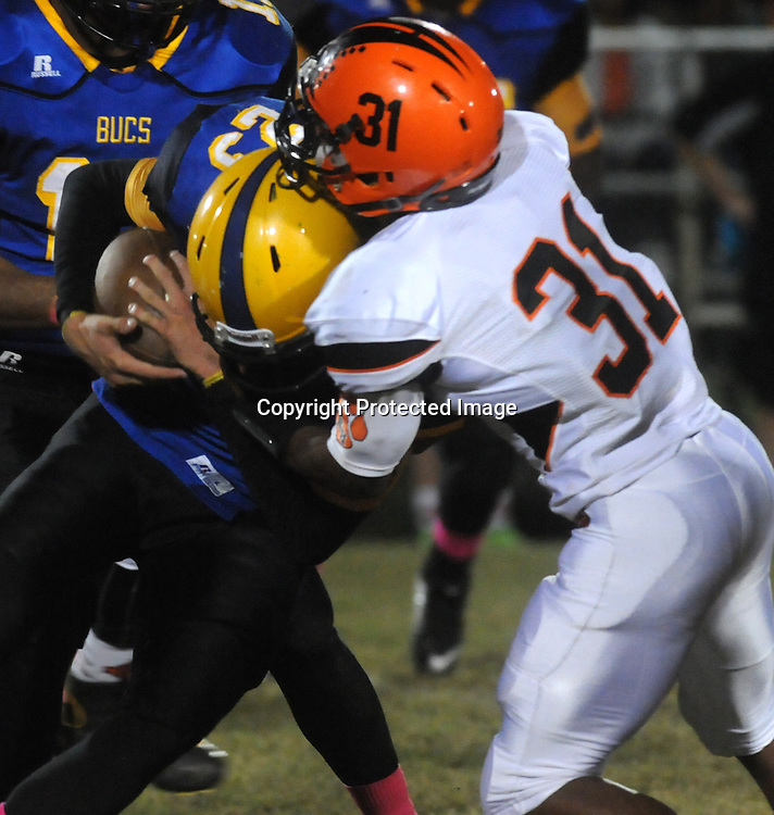 Laney High School's Christian Cox is tackled by New Hanover High School's Blake Cromartie Friday October 17, 2014. (Jason A. Frizzelle)