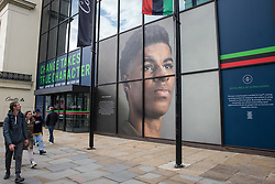 London, UK. 15th October, 2021. A window display at Coutts' headquarters in the Strand celebrates footballer Marcus Rashford MBE as part of Black History Month. Black History Month, first celebrated in the UK in October 1987, is themed around a 'Proud To Be' campaign for 2021 inspired by the 2020 Black Lives Matter events.