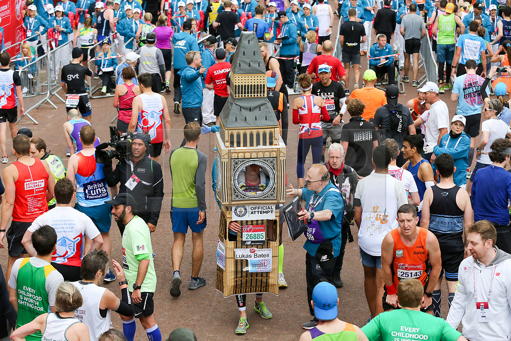 © Licensed to London News Pictures. 28/04/2019. London, UK.  A man dressed in Big Ben amongst the mass of runners at the finish of 2019 Virgin Money London Marathon. Photo credit: Dinendra Haria/LNP