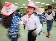 """Lyons Elementary School first graders students perform """"Dance Across Texas"""" for parents and staff to kick off Go Texan week, February 24, 2014."""