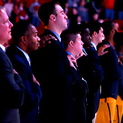 Toledo coaches and players place a hand on their teammate's shoulders during the national anthem before the game at Ball State University's Worthen Arena in Muncie, Ind., on Saturday, February 17, 2018. THE BLADE/KURT STEISS