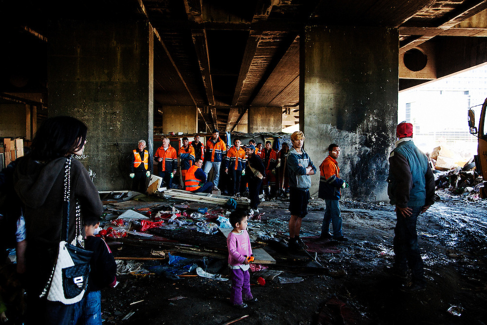 City workers arrive in an area under the New Belgrade train station where many families were living. They are waiting to pack belongings in to city trucks for relocation. The Belville camp in New Belgrade on the morning of its destruction by the Belgrade city government.