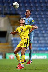 Oxford United's Sam Smith (left) and Coventry City's Tom Davies (back) battle for the ball