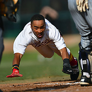 PCC left fielder Aryonis Harrison dives head first into home to score a run in a baseball game between Pasadena City College and Cerritos College at Jackie Robinson Field,  Thursday, Mar. 05, 2020, in Pasadena, CA. (Mandatory Credit: Glen Pascual -Sports Shooter Academy)