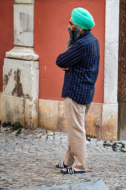 An Indian Gentleman outside a Indian Restaurant in Tavira, Portugal