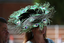 A fashionable racegoer during day three of Royal Ascot at Ascot Racecourse. PRESS ASSOCIATION Photo. Picture date: Thursday June 21, 2018. See PA story RACING Ascot. Photo credit should read: Nigel French/PA Wire. RESTRICTIONS: Use subject to restrictions. Editorial use only, no commercial or promotional use. No private sales.