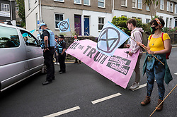 © Licensed to London News Pictures; 11/06/2021; St Ives, Cornwall UK. G7 summit in Cornwall. Police speak to a motorist trying to get through an XR cordon shutting off the road before a protest by Extinction Rebellion in St Ives on the first day of the G7 summit. Photo credit: Simon Chapman/LNP.