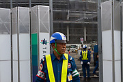A security guard mans a gate  at the construction site for the new main stadium for the 2020 Tokyo Olympics in Gaiemmae, Tokyo, Japan Tuesday June 26th 2018. After many delays the main stadium construction is expected to be finished by November 2019. The Tokyo 2020 Olympics will take place from July 24th to August 9th  2020
