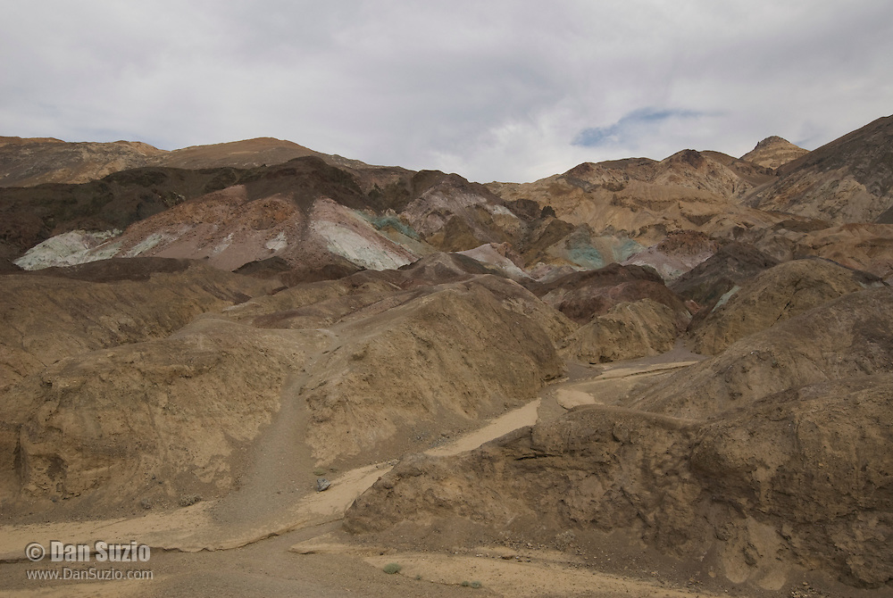 A cloudy sky mutes the colors of the rock at Artist's Palette, Death Valley National Park, California