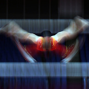 A blur of motion as a Chinese gymnast performs on the uneven bars during the Women's Artistic Gymnastics podium training at North Greenwich Arena during the London 2012 Olympic games preparation at the London Olympics. London, UK. 26th July 2012. Photo Tim Clayton