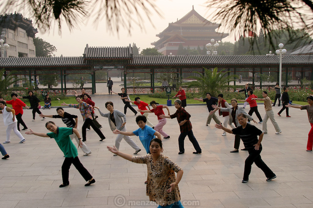With Beijing's Forbidden City glowing mistily in the background, a group of middle-aged women in Zhongshan Park practices the long-standing tradition of morning group dance and exercise. Hungry Planet: What the World Eats (p. 79). This image is featured alongside the Dong family images in Hungry Planet: What the World Eats.