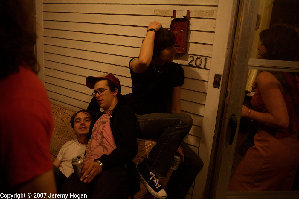 A group hangs out after a punk show at the Guilty Pleasures punk house.
