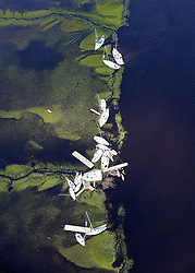 Boats blown away from their docks sit in the marsh after Hurricane Irma passed on Tuesday, September 12, 2017, at St. Marys on the Georgia coast. Photo by Curtis Compton/Atlanta Journal-Constitution/TNS/ABACAPRESS.COM