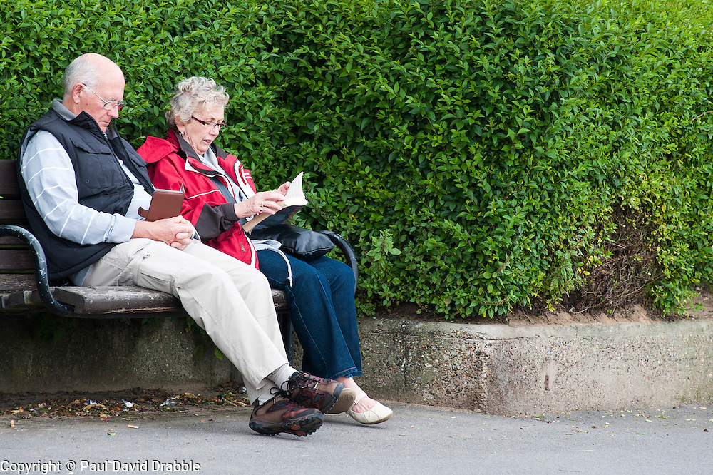 A couple sat on Cleethorpes sea front reading ..1 July 2012.Image © Paul David Drabble