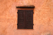 San Gimignano - Monday, May 10 2004: Window shutters. (Photo by Peter Horrell / http://www.peterhorrell.com)