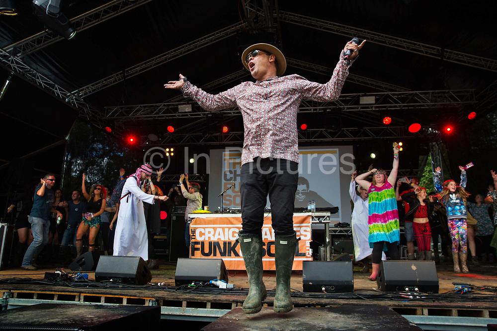 Dancing to Criag Charles on the Hell Stage, Shangri La field, Glastonbury Festival 2016. The Glastonbury Festival is the largest greenfield festival in the world, and is now attended by around 175,000 people. Its a five-day music festival that takes place near Pilton, Somerset, United Kingdom. In addition to contemporary music, the festival hosts dance, comedy, theatre, circus, cabaret, and other arts. Held at Worthy Farm in Pilton, leading pop and rock artists have headlined, alongside thousands of others appearing on smaller stages and performance areas.
