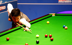 Ding Junhui in action against Ronnie O'Sullivan, on day twelve of the Betfred Snooker World Championships at the Crucible Theatre, Sheffield.