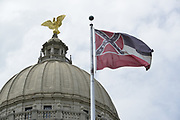 Pictured is the Mississippi State Capitol  still flying the Mississippi flag with the Confederate emblem on it, just hours before Governor Tate Reeves signed a historic Bill HB1796 decommissioning the state flag and opening the door to a new flag without the Confederate emblem that has flown for 126 years.<br /> <br /> A Mississippi flag flies at the governors mansion in Jackson, Mississippi, U.S., June 30, 2020.  Photo ©/Suzi Altman