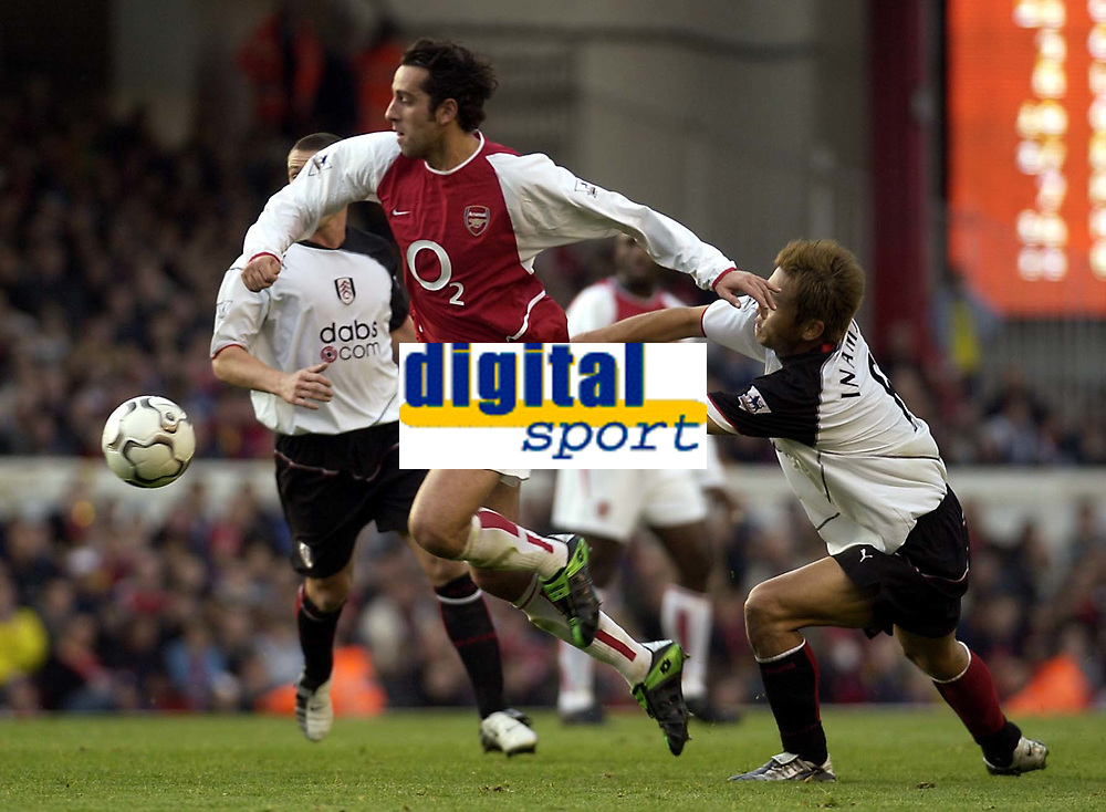 Picture: Henry Browne.<br />Date: 30/11/2003.<br />Arsenal v Fulham  FA Barclaycard Premiership.<br />Junichi Inamoto of Fulham tries to get hold of Arsenal's Edu