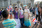SCENES IN THE CROWD The Royal Wedding of Prince William and  Catherine Middleton. Scenes around Buckingham Palace and the Mall.   London. 29 April 2011. , -DO NOT ARCHIVE-© Copyright Photograph by Dafydd Jones. 248 Clapham Rd. London SW9 0PZ. Tel 0207 820 0771. www.dafjones.com.
