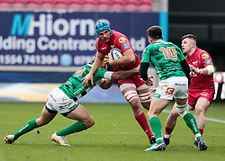 Scarlets' Tadhg Beirne is tackled by Benetton Rugby's Angelo Esposito<br /> <br /> Photographer Simon King/Replay Images<br /> <br /> EPCR Champions Cup Round 3 - Scarlets v Benetton Rugby - Saturday 9th December 2017 - Parc y Scarlets - Llanelli<br /> <br /> World Copyright © 2017 Replay Images. All rights reserved. info@replayimages.co.uk - www.replayimages.co.uk