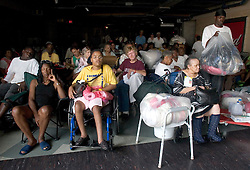 31st August, 2005. New Orleans, Louisiana. <br /> 'Hell on earth.' Saved from the Superdome where over 20,000 refugees from hurricane Katrina are crammed into hellish conditions, storm survivors with medical conditions await evacuation.<br /> Photo Credit: Charlie Varley/varleypix.com