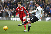 Derby County defender Richard Keogh clears the ball from danger during the Sky Bet Championship match between Derby County and Cardiff City at the iPro Stadium, Derby, England on 21 November 2015. Photo by Aaron Lupton.