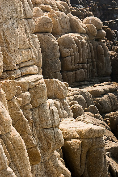 Rocks eroded into unusual rounded forms on the coast in Maruata Bay, Michoacan State, Mexico. Maruata is a Pomaro fishing village set in a beautiful bay and a popular destination among independent-minded travelers.
