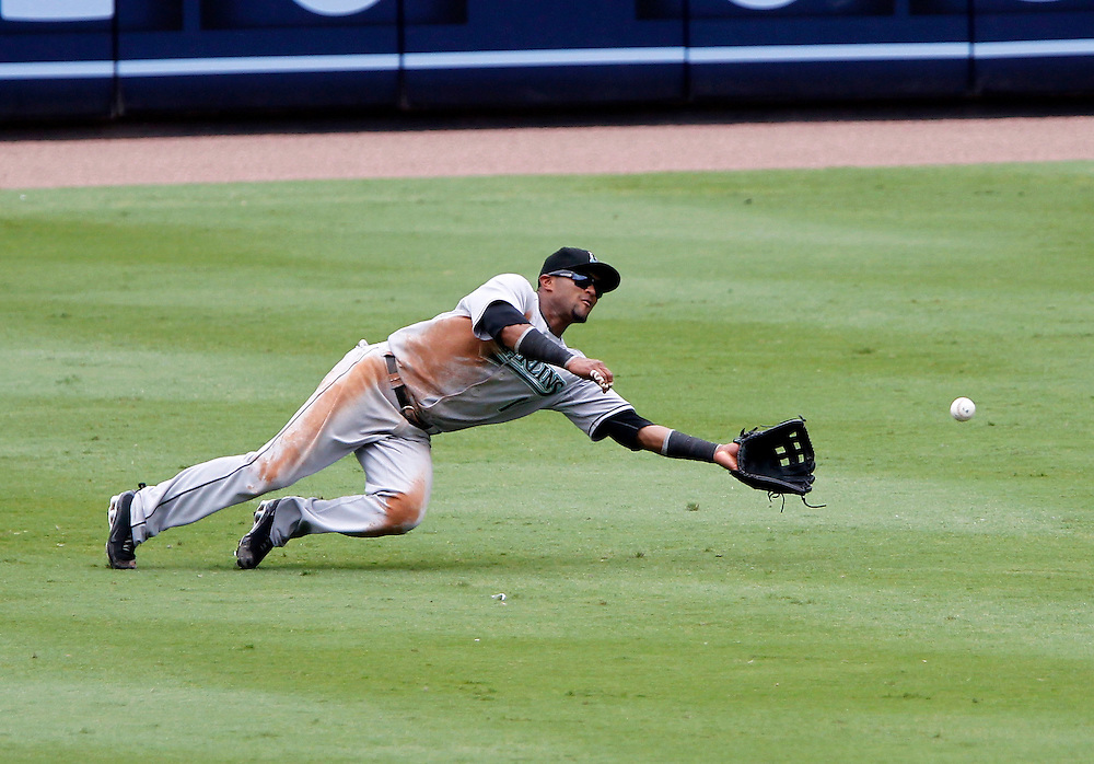 ATLANTA - AUGUST 29:  Centerfielder Emilio Bonifacio #1 of the Florida Marlins dives to catch a ball during the game against the Atlanta Braves at Turner Field on August 29, 2010 in Atlanta, Georgia.  The Braves beat the Marlins 7-6.  (Photo by Mike Zarrilli/Getty Images)