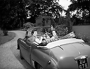 Nellie Mulcahy  special at RDS Horse Show and Rathmines, Special for Ita Hynes.04/08/1953..Nelli Mulcahy was a fashion designer who's designs were inspired by native fabrics and turned into high fashion garments. Hillman Minx convertible car