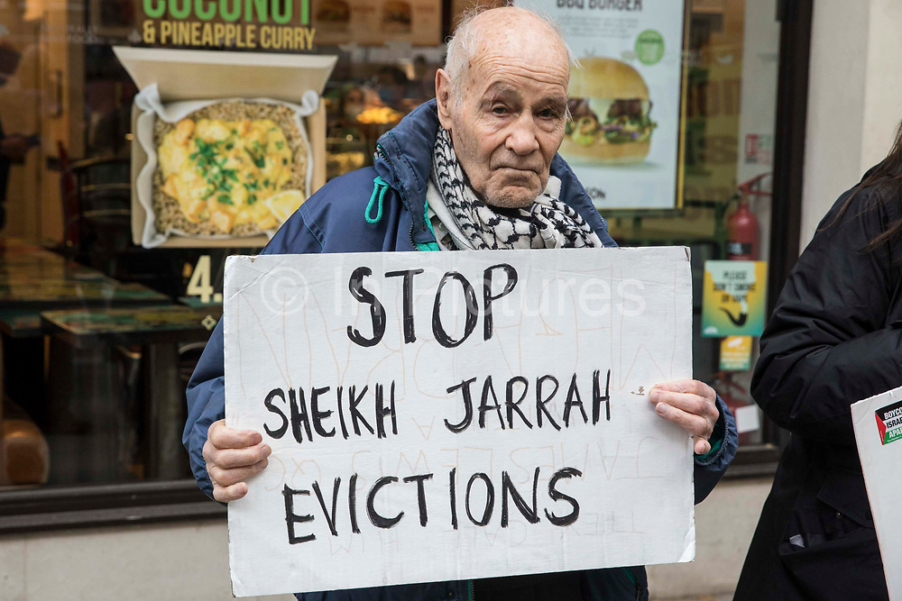 Pro-Palestinian activist Eric Levy, 92, holds a sign calling for an end to evictions in Sheikh Jarrah at a protest outside the UK headquarters of Elbit Systems, an Israel-based company developing technologies used for military applications including drones, precision guidance, surveillance and intruder-detection systems, on 11th May 2021 in London, United Kingdom. Activists from Palestine Action were protesting against the companys presence in the UK and in solidarity with the Palestinian people at a time of a significant rise in tension in Israel and the Occupied Territories following attempts at forced evictions of Palestinian families in the Sheikh Jarrah neighbourhood of East Jerusalem, the deployment of Israeli forces at the Al-Aqsa mosque and the killing of children in Gaza.