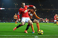 Wayne Rooney of Manchester United and Hull's Andrew Robertson contest a loose ball resulting in Rooney falling into the advertising boards - Manchester United vs. Hull City - Barclay's Premier League - Old Trafford - Manchester - 29/11/2014 Pic Philip Oldham/Sportimage