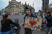 Protesters gathered outside the Houses of Parliament in Westminster, central London on Wednesday, March 31, 2021, to demonstrate against the February 1 Military Coup D'etait in Myanmar which ousted Aung San Suu Kyi's elected government. (Photo/ Vudi Xhymshiti)
