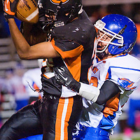 102512       Cable Hoover<br /> <br /> Gallup Bengal Adrian Nakai (36) jumps past Los Lunas Tiger Zach Perales (29) to receive a pass Thursday at Public School Stadium.