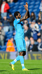 Emmanuel Adebayor (TOG) of Tottenham Hotspur looks frustrated with a draw as he applauds the travelling support - Photo mandatory by-line: Rogan Thomson/JMP - 07966 386802 - 12/04/2014 - SPORT - FOOTBALL - The Hawthorns Stadium - West Bromwich Albion v Tottenham Hotspur - Barclays Premier League.