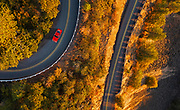 Image of a Red Porsche 911 S on a curvy road at the Columbia River Gorge in Oregon, Pacific Northwest by Randy Wells