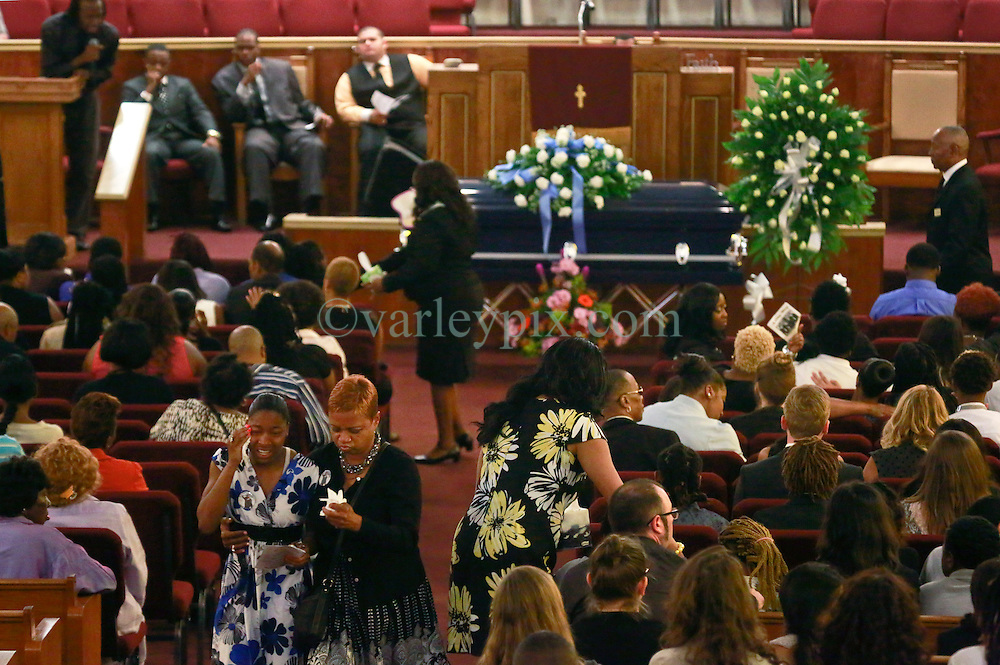 14 May 2014. New Orleans, Lousiana. <br /> Funeral for teenage shooting victim Miqual Jackson at the New Hope Baptist Church. A classmate of the victim leaves in floods of tears. 14 year old Jackson was shot in the back of the head May 5th and died shortly afterwards. His 15 year old brother  Lamichael was hit in the leg and survived. 52 year old Gregory Johnson is wanted on 1st degree murder charges. Randy Pittman, 49, an associate of Johnson's was arrested on 3 counts of being a principal to 1st degree murder. The New Hope Baptist Church witnessed the funeral of 1 year old Londyn Samuels who was also gunned down in cold blood on the streets of New Orleans 8 months ago.<br /> Charlie Varley/varleypix.com