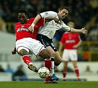 Photo. Chris Ratcliffe<br /> Tottenham Hotspur v Charlton Athletic. <br /> FA Premiership. 28/12/2003<br /> Jason Euell of Charlton and Robbie keane battle it out