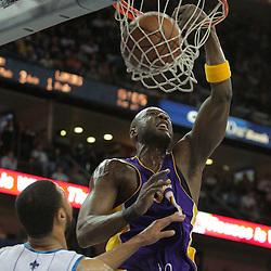 23 December 2008: Los Angeles Lakers forward Lamar Odom (7) dunks over New Orleans Hornets center Tyson Chandler (6) during a 100-87 loss by the New Orleans Hornets to the Los Angeles Lakers at the New Orleans Arena in New Orleans, LA. .