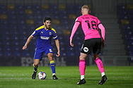 AFC Wimbledon defender Will Nightingale (5) takingon Peterborough United defender Frazer Blake-Tracy (18) during the EFL Sky Bet League 1 match between AFC Wimbledon and Peterborough United at Plough Lane, London, United Kingdom on 2 December 2020.