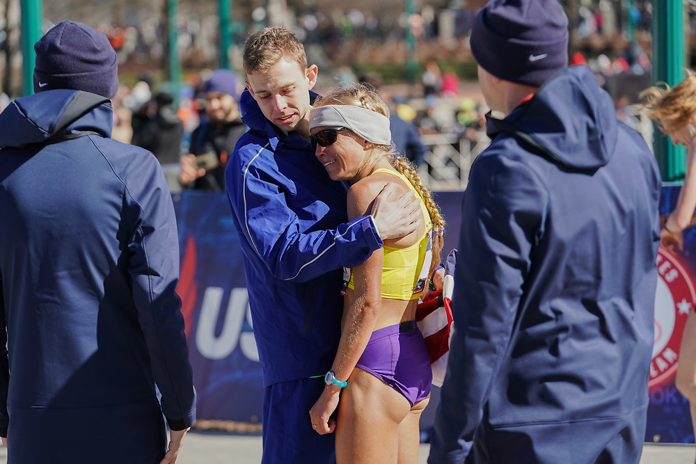 Galen Rupp consoles a sobbing Jordan Hasay during the 2020 U.S. Olympic marathon trials in Atlanta on Saturday, Feb. 20, 2020. Hasay, who finished 26th, was a favorite for the race. Rupp won the men's division. Photo by Kevin D. Liles for The New York Times
