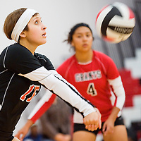 103012       Cable Hoover<br /> <br /> Grants Pirate Roxanne Autrey (15) bumps the ball over to the Gallup Bengals Tuesday at Grants High School.